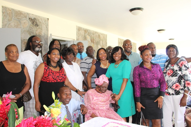 "Celian ""Martin"" Powell surrounded by her family during her 103rd birthday on January 19, 2015, at the Flamboyant Nursing Home"