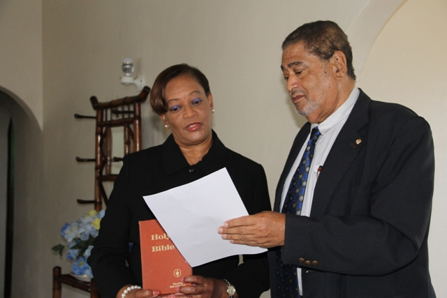New Resident Judge for the Nevis High Court, Nevis Circuit Justice Lorraine Williams takes her oath before Deputy Governor General His Honour Eustace John at his Bath Plain Office on January 12, 2015