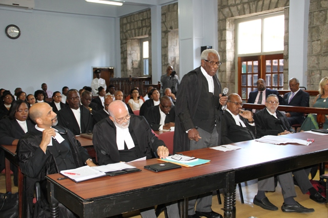 Senior Counsel on Nevis Theodore Hobson addressing a special sitting at the High Court in Nevis while other members of the St. Kitts-Nevis Bar Association look on