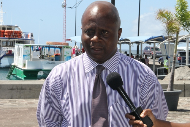 Permanent Secretary in the Premier's Ministry Wakely Daniel seeing off the Nevis 6th Form College's Literary and Debating Society Debaters on Wednesday 25th February, 2015 at the Charlestown Pier.