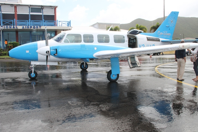 The Caribbean Helicopters Limited aircraft landing at the Vance W. Amory International Airport on February 20, 2015