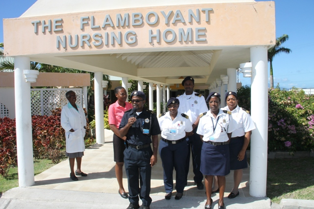 Assistant Controller of St. Kitts and Nevis Customs and Excise Department, Nevis Division Roger Fyfield speaking to the Department of Information on January 29, 2015 outside the Flamboyant Nursing Home. He is flanked by other members of the Division