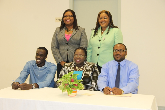 Junior Minister responsible for the Department of Youth and Sports Hon. Hazel Brandy-Williams (seated second from left) with personnel at the department. (Seated left) Stephan Joseph, (seated right) Acting Director of Sports Jamir Claxton (standing L-R) Coordinator of Youth Development Zhanela Claxton and Assistant Permanent Secretary in the Ministry of Social Development D. Michelle Liburd at the Department of Youth and Sports website launch on February 09, 2015 at the Emergency Operations Centre at Long Point