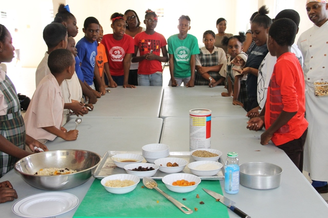 Students of the Charlestown Primary School participating in a Mini Chef Academy at the school's kitchen on February 24, 2015, hosted by the Rouse Foundation, in collaboration with the Nevis Island Administration