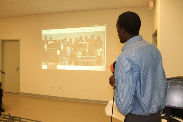 Youth Development Officer Stephan Joseph presents the Department of Youth and Sports website at its launch on February 09, 2015 at the Emergency Operations Centre at Long Point