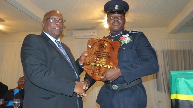 Constable of the Year of the Nevis Division of the Royal St. Christopher and Nevis Police Force #750 Kishorn Charles of the Violent Crimes Unit receiving his recognition plaque from Prime Minister and Minister of National Security Hon. Timothy Harris