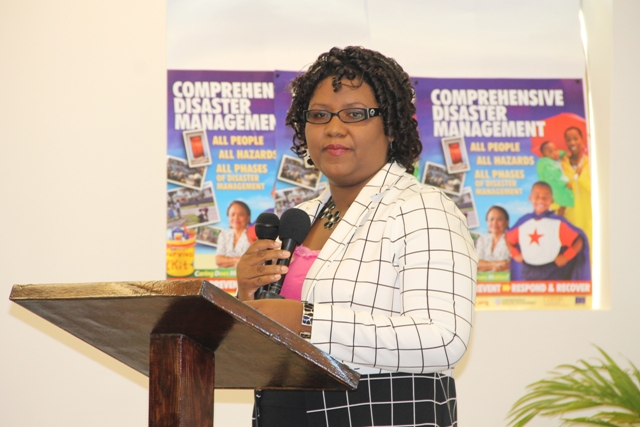 Chairperson and Coordinator of Youth in the Department of Youth and Sports Zahnela Claxton delivering opening remarks at the UNESCO Youth for Human Rights Awareness Training for Trainers Workshop on March 4, 2015 at the Disaster Management Department's Emergency Operation Center Conference Room.