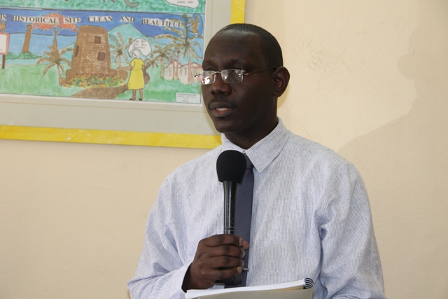 Policy and Regulations Officer in the Ministry of Tourism John Hanley giving brief remarks at the Taxi Permit Handing over Ceremony at The Nevis Island Administration Building on March 11, 2015.