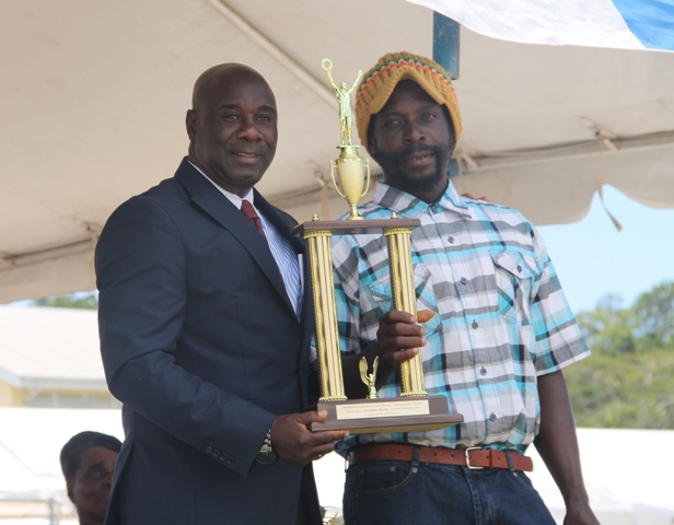 Top livestock farmer in Nevis for 2014 Livingston Hanley receives his Department of Agriculture award from Minister of Agriculture Hon. Alexis Jeffers at the 21st Annual open Day hosted by the Department of Agriculture