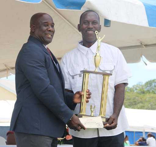 Top crop farmer in Nevis for 2014 Junior Jonas receives his Department of Agriculture award from Minister of Agriculture Hon. Alexis Jeffersat the 21st Annual open Day hosted by the Department of Agriculture