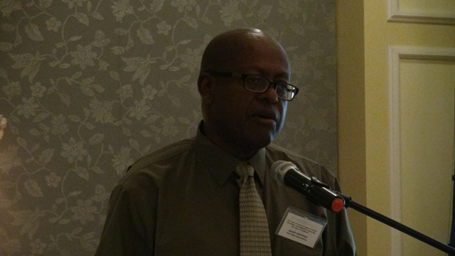Key speaker and Financial Advisor for the Nevis Island Administration Laurie Lawrence delivering remarks at the Nevis Financial Services Regulation and Supervision Department 2015 Anti-Money Laundering (AML) and Countering Financing of Terrorism (CFT) Awareness Seminar and Training Workshop on March 3 and 4, 2015 at the Four Seasons Resort Conference Room.