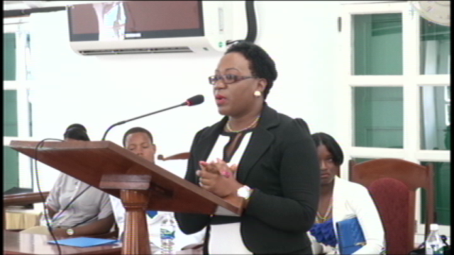Clerk of the House Shemica Maloney giving brief remarks after special sitting at The Nevis Island Assembly On March 9, 2015