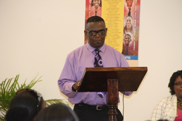 Secretary General for the SKN Commission for UNESCO Antonio Maynard delivering remarks at the UNESCO Youth for Human Rights Awareness Training for Trainers Workshop on March 4, 2015 at the Disaster Management Department's Emergency Operation Center Conference Room