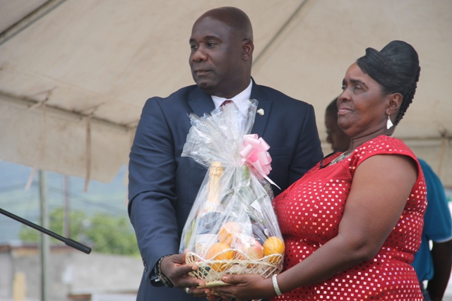 Minister of Agriculture on Nevis Hon. Alexis Jeffers presents a gift basket to Patron of the Department of Agriculture's 21st annual Open Day Roslyn Cranston at the opening ceremony at the Villa in Charlestown on March 26, 2015