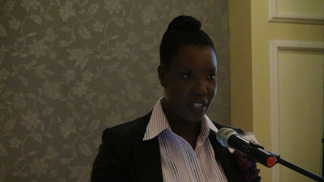 Regulator Heidi-Lynn Sutton delivering welcome remarks at the Nevis Financial Services Regulation and Supervision Department 2015 Anti-Money Laundering (AML) and Countering Financing of Terrorism (CFT) Awareness Seminar and Training Workshop on March 3 and 4, 2015 at the Four Seasons Resort Conference Room.