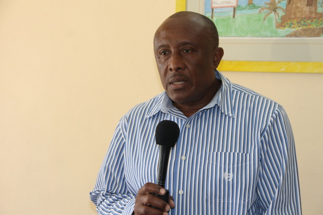 Acting Permanent Secretary of Tourism Mr. Carl Williams giving brief remarks at the Taxi Permit Handing over Ceremony at The Nevis Island Administration Building on March 11, 2015.