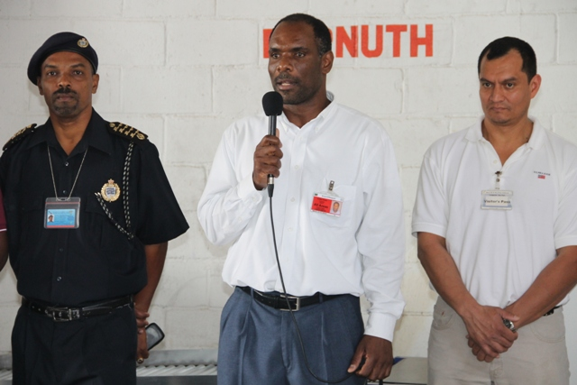 (L-R)Deputy Comptroller of Customs Cynric Carey, Permanent Secretary in the Ministry of Finance in the Nevis Island Administration (NIA) Colin Dore and Co-Founder of Security Equipment Services and Representative for Autoclear, the manufacturer of the X-ray system Salvador Leanos at the X-ray inspection system Handing Over Ceremony on March 13,2015 at the Long Point Port