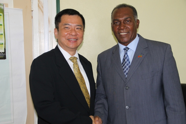 Premier of Nevis Hon Vance Amory (right) welcomes Resident Ambassador of the Republic of China (Taiwan) of St.Kitts and Nevis His Excellency George Gow Wei Chiou during a courtesy call on April 08, 2015, at the Nevis Island Administration building at Bath Plain