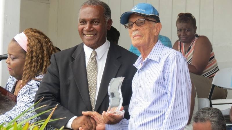 Premier of Nevis Hon Vance Amory presenting Arthur Evelyn with his award at the Gulf Insurance Inter-Primary Schools Championship Opening Ceremony Elquemedo T. Willett Park on April 01, 2015