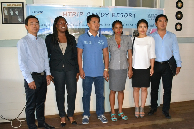 (L-R) Assistant General Manager of HTRIP Allen Huang, Local Business Manager of HTRIP Terrelah Byron, Chief Executive Officer and Director of HTRIP and 1st Director of Caribbean Development Consultant Ltd. Mr. Jian Li, Administrative Assistant of HTRIP Latoya Claxton, Client Services Manager of HTRIP Fiona Lei and General Manager of HTRIP David Liu at the HTRIP Press Conference at the Riviere House, Government Road Nevis on April 23, 2015