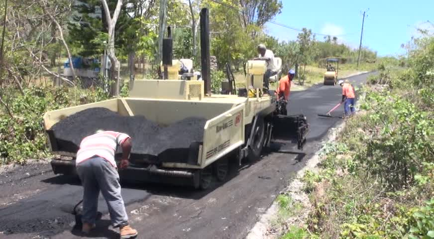 The Public Works Department doing finishing works on a road project which connects Lampa Hill to Bailey Yard, Cole Hill and Brown Hill