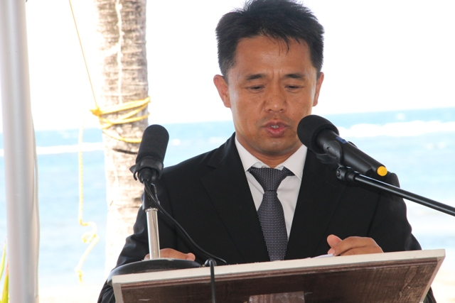 Chief Executive Officer and General Manager of HTRIP and 1st Director of CDCL Mr. Jian Li delivering remarks at the ground breaking ceremony for the HTRIP Candy Resort Villa Development at Liburd Hill, St. James Parish in Nevis on April 17, 2015