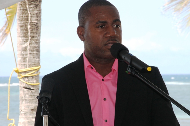 Deputy Prime Minister of St. Kitts and Nevis Hon. Shawn Richards delivering remarks at the ground breaking ceremony of the HTRIP Candy Resort Villa Development at Liburd Hill on Nevis on April 17, 2015