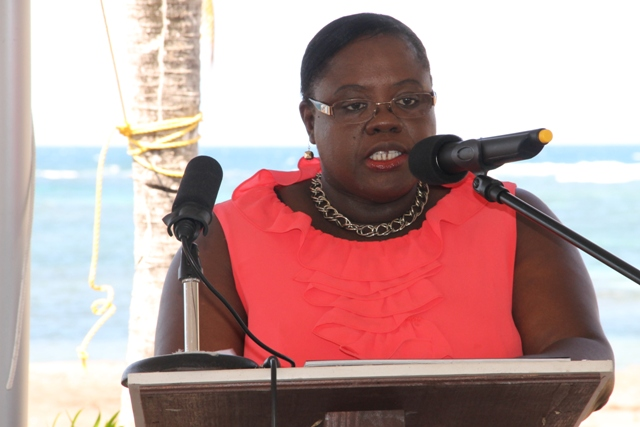 Junior Minister in the Nevis Island Administration Hon. Hazel Brandy-Williams delivering remarks at the ground breaking ceremony for the HTRIP Candy Resort Villa Development at Liburd Hill, St. James Parish in Nevis on April 17, 2015