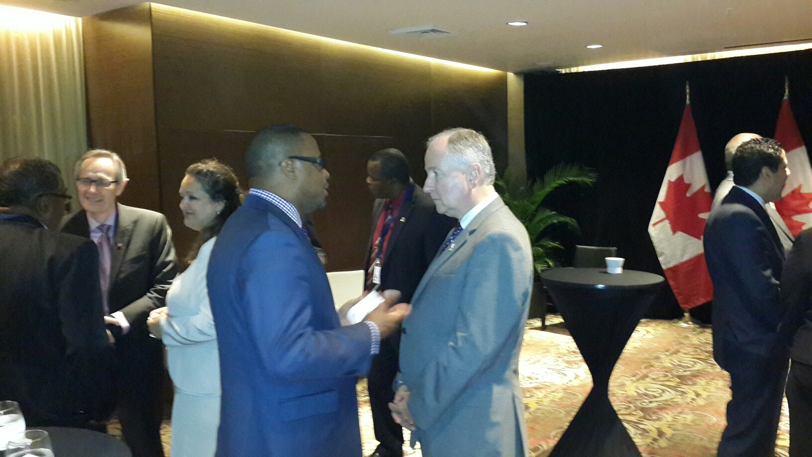 St. Kitts and Nevis Foreign Affairs Minister and Deputy Premier of Nevis Hon. Mark Brantley (center left) with Canadian Foreign Affairs Minister Rob Nicholson (center right) on April 10, 2015, at a cocktail hosted by the Canadian Official for Caribbean Community Foreign Affairs Ministers attending the Summit of the Americas in Panama