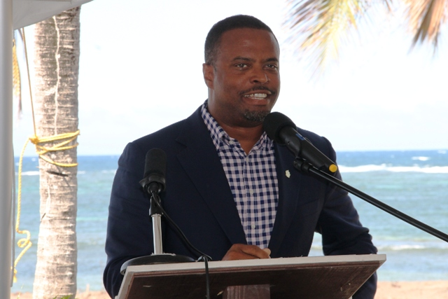 Deputy Premier of Nevis and Minister of Tourism Hon. Mark Brantley delivering remarks at the ground breaking ceremony of the HTRIP Candy Resort Villa Development at Liburd Hill on Nevis on April 17, 2015