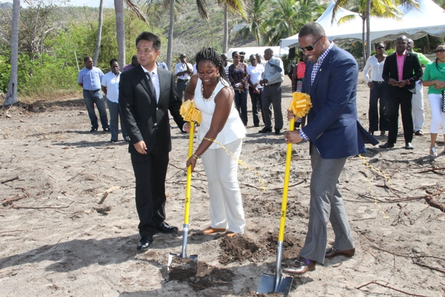 Deputy Premier of Nevis and Minister of Tourism Hon. Mark Brantley and Candy Resort's Local Office Executive Terrehah Byron break ground for the US$20 million HTRIP Candy Resort Villa Development at Liburd Hill, St. James' Parish on Nevis on April 17, 2015