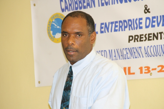 Permanent Secretary in the ministry of Finance Colin Dore delivering remarks at the opening ceremony of the Caribbean Development Bank Management Accounting Systems for MSMEs eight-day workshop on April 13, 2015 at the Ministry of Education's Conference Room