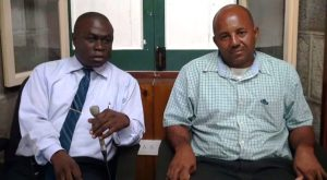 """Manager at the Nevis Solid Waste Management Authority Andrew Hendrickson and new Operations Manager Dennis """"Rudy"""" Browne"""