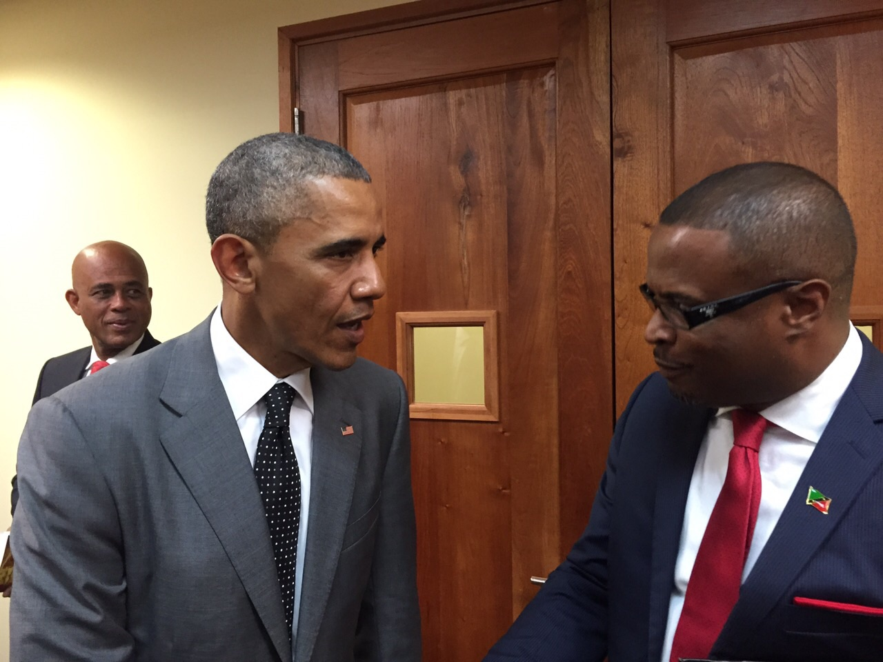 Federal Minister of Foreign Affairs and Deputy Premier of Nevis Hon. Mark Brantley (right) speaks with United States of America President Barack Obama during the US-CARICOM Summit in Jamaica on April 09, 2015