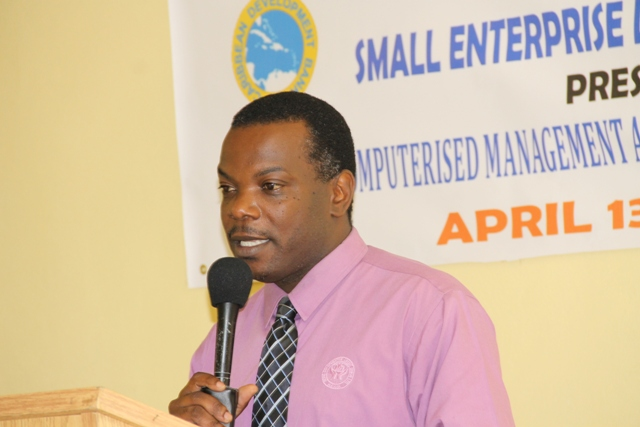 Assistant Manager at the Nevis Corporative Credit Union Ken Williams delivering remarks at the opening ceremony of the Caribbean Development Bank-sponsored Management Accounting Systems for MSMEs workshop on April 13, 2015 at the Department of Education's Conference Room