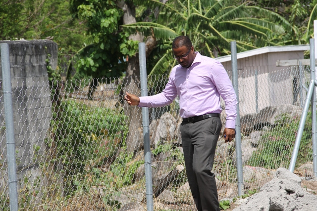 Deputy Premier of Nevis Hon Mark Brantley walking along recently fence area