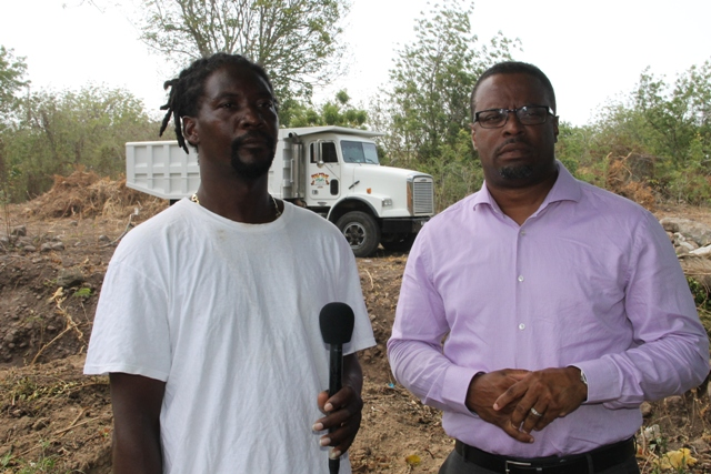 (L-R) Managing Director of DC Equipment and Stoney Grove resident Dale Claxton and Deputy Premier of Nevis Hon Mark Brantley on site at the Upper Stoney Grove ghaut on Friday 8th May, 2015