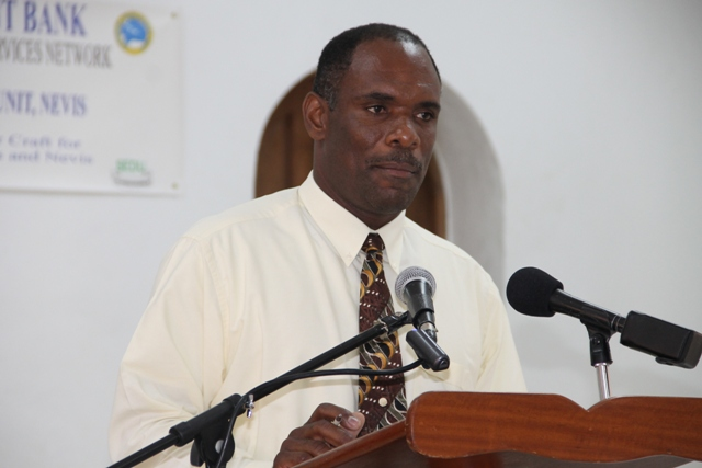 Permanent Secretary in the Ministry of Finance Colin Dore at the opening ceremony of the Caribbean Development Bank-sponsored Intermediate Leather Craft Workshop on May 11, 2015 at St.Pauls Anglican Church School Hall