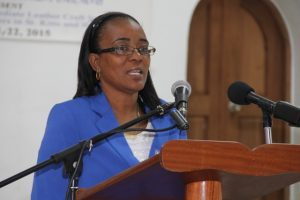 Head of the Small Enterprise Development Unit Catherine Forbes at the opening ceremony of the Caribbean Development Bank-sponsored Intermediate Leather Craft Workshop on May 11, 2015 at St.Pauls Anglican Church School Hall