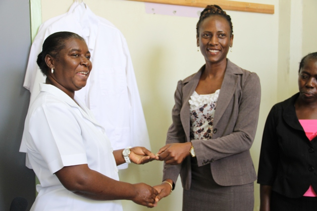 Health Planner in the Ministry of Health Shelisa Martin Clarke hands over keys to Nurse Manager of the Alexandra Hospital Laurel Smithen on behalf of The Nevis Maternal Fund and Voices of Women.