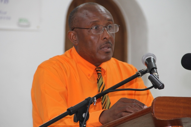 Permanent Secretary in the Ministry of Tourism Carl Williams at the opening ceremony of the Caribbean Development Bank-sponsored Intermediate Leather Craft Workshop on May 11, 2015 at St.Pauls Anglican Church School Hall