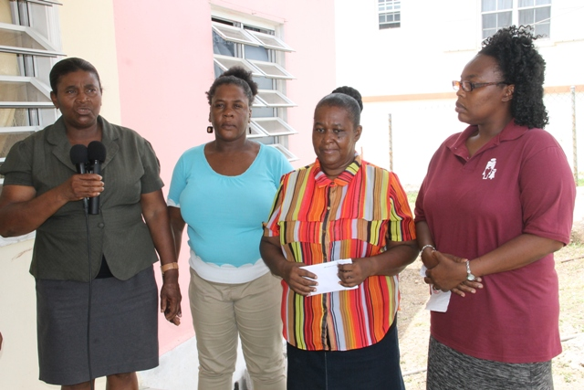 (L-R) Co-ordinator of the Department of Social Services Single Parents Group Grace Manners alongside members of the Single Parents Group - Lydia Lawrence, Gloria Pemberton and Rhonda Forbes at the home of cancer patient Raymond Maynard on June 23, 2015 making a donation to assist with his medical expenses