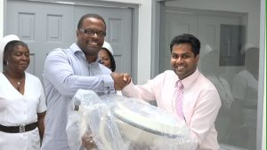 President of the MUA Student Government Vivek Govardhanam presenting the lighting equipment to Minister of Health Hon. Mark Brantley at the handing over ceremony at the Alexandra Hospital on June 12, 2015