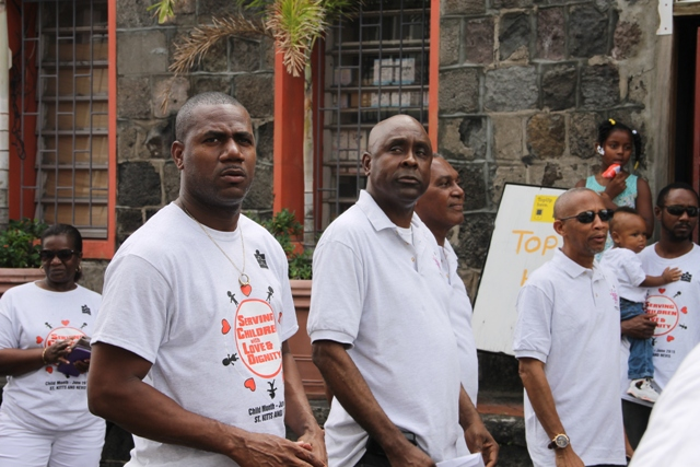 (L-R) Deputy Prime Minister and Minister of Education in St. Kitts Hon. Shawn Richards, Cabinet Secretary Mr. Stedmond Tross, Premier of Nevis and Minister of Education Hon. Vance Amory and Legal Advisor Colin Tyrell at the annual Child Month Parade in Charlestown on June 15, 2015