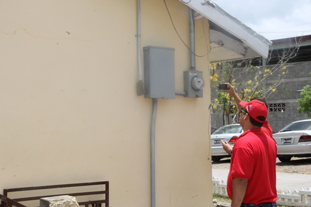 Member of the Venezuelan delegation assessing the electricity supply at the Charlestown Secondary School on June 04, 2015