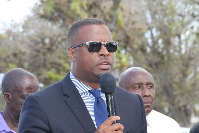 Deputy Premier of Nevis Hon. Mark Brantley delivering remarks at a memorial service for the late Malcolm Guishard at the Bath Cemetery on June 11, 2015