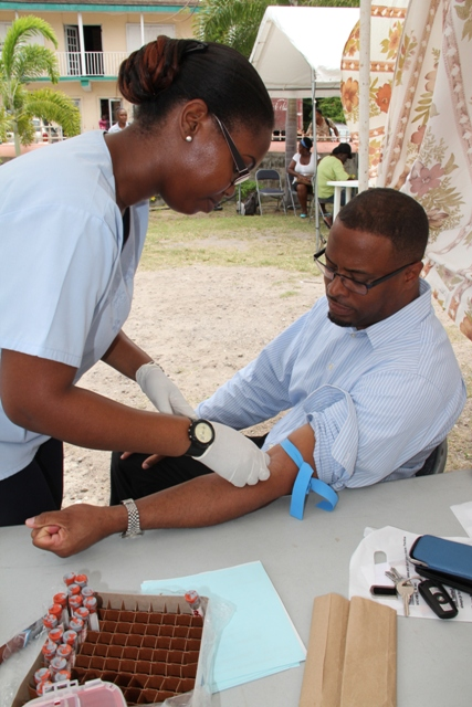 Deputy Premier of Nevis and Minister of Health Hon. Mark Brantley takes time to know his status at a Ministry of Health's Voluntary Counselling and Testing (VCT) event (file photo)