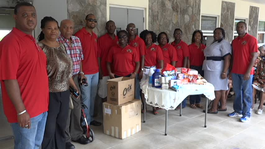 Members of the Cuban Alumni Association with donation to the Flamboyant Nursing home on Nevis on June 20, 2015. (Third and second from left respectively) Association Vice President Retna Walwyn-Browne and Nursing Assistant at the Flamboyant Home Cacelia Stanley and (Second and third from left respectively) Telca Wallace President of the Cuba St. Kitts Nevis Friendship Association and Public Relations Officer Earl Clark
