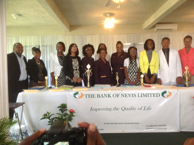 (L-R) Bank of Nevis Ltd Board Member Ron Daniel, Tourism, Youth Congress participant from the Gingerland Secondary School Vinicia Gumbs, participant from the Charlestown Secondary School Shanai Liburd, Tarana Kacker, Participant from the Nevis International Secondary School, BON staff members Zadia Browne, Dianne Newton, Janice Hodge, BON Human Resources Manager Shirletta Byron, participant from the NISS Kayla Sandiford, GSS participant Sabrina Orr, CSS participant K-Jel Smithen and BON Chief Operating Officer Lisa Herbert
