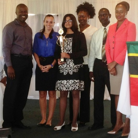 (L-R) Chief Executive Officer of the Nevis Tourism Authority Greg Phillip, Principal of the Nevis International Secondary School Joy Napier, 2015 Youth Congress winner Tarana Kacker, Teacher/Chaperon Latoya Blair, Policy and Regulations Officer, Ministry of Tourism John Hanley and Chief Operating Officer at the Bank of Nevis Ltd. Lisa Herbert